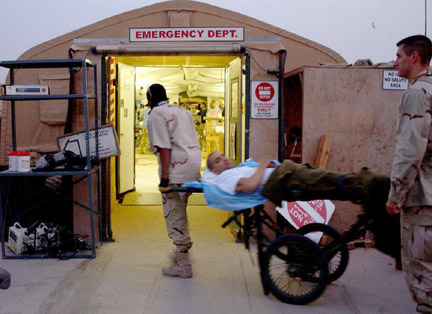 Medical personnel carry a wounded service member<b></b>